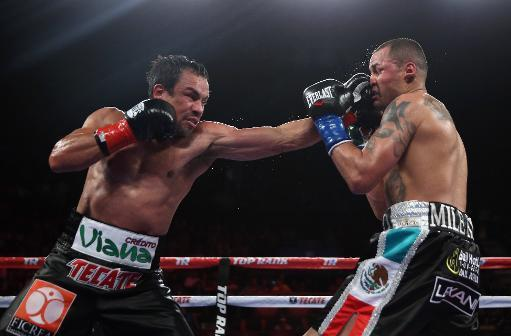 Juan Manuel Marquez (L) lands a left to the chin of Mike Alvarado at The Forum on May 17, 2014 in Inglewood, California