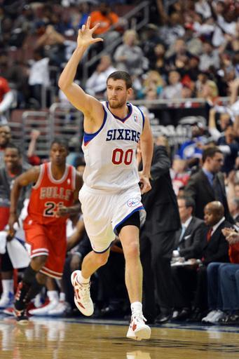 PHILADELPHIA, PA - MAY 06: Spencer Hawes #00 of the Philadelphia 76ers celebrates a 3 point shot at the end of the first half against the Chicago Bulls in Game Four of the Eastern Conference Quarterfinals in the 2012 NBA Playoffs at the Wells Fargo Center on May 6, 2012 in Philadelphia, Pennsylvania. (Photo by Drew Hallowell/Getty Images)