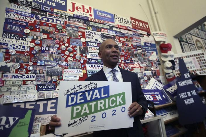 Democratic presidential candidate former Massachusetts Gov. Deval Patrick adds his campaign sign to pins, signs and bumper stickers of New Hampshire primary presidential contenders on display in the State House visitors center, Thursday, Nov. 14, 2019, in Concord, N.H. Patrick's candidacy presents a question for Democrats. With four white candidates sitting atop the primary field, electability isn't just about whether there's a white candidate who can appeal to black voters, but whether any of the three black candidates can appeal to white voters.(AP Photo/Charles Krupa)