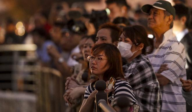 People watch as Shuri Castle burns down. Photo: Kyodo