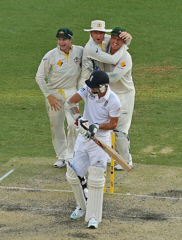 BRISBANE, AUSTRALIA - NOVEMBER 24:  Steven Smith, Michael Clarke and Brad Haddin celebrate as last man out James Anderson of England is dismissed during day four of the First Ashes Test match between Australia and England at The Gabba on November 24, 2013 in Brisbane, Australia.  (Photo by Scott Barbour/Getty Images)