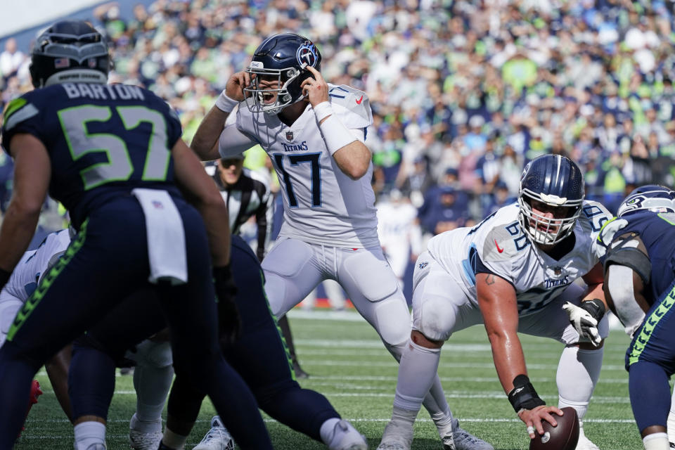 Tennessee Titans quarterback Ryan Tannehill calls to his team as he lines up under center Ben Jones (60) during the second half of an NFL football game against the Seattle Seahawks, Sunday, Sept. 19, 2021, in Seattle. (AP Photo/Elaine Thompson)