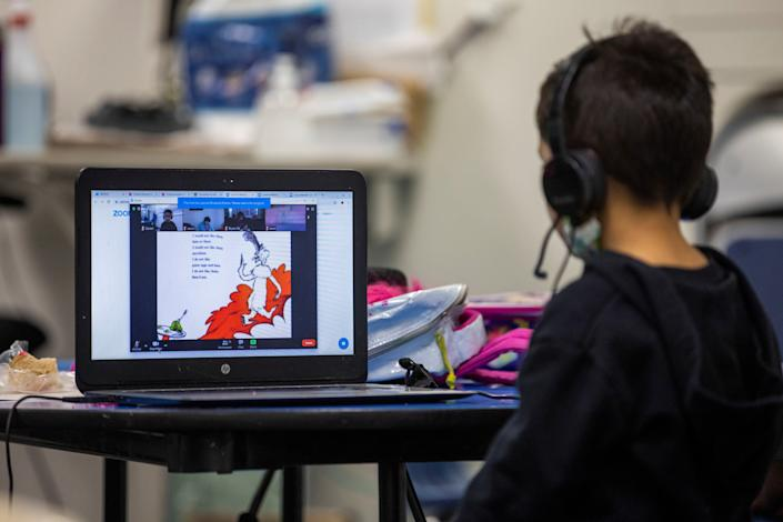 Daniel, 5, watches Dr. Seuss during a zoom class as the Westchester Family YMCA provides a safe distance learning environment for local students during the outbreak of the coronavirus disease (COVID-19) in Los Angeles, California, U.S., March 2, 2021. (Mike Blake/Reuters)