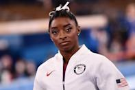 """<p>On July 28, USA Gymnastics announced Biles' <a href=""""https://people.com/sports/tokyo-olympics-simone-biles-withdraws-individual-all-around-gymnastics/"""" rel=""""nofollow noopener"""" target=""""_blank"""" data-ylk=""""slk:first of four withdrawals"""" class=""""link rapid-noclick-resp"""">first of four withdrawals</a> from event finals.</p> <p>""""After further medical evaluation, Simone Biles has withdrawn from the final individual all-around competition at the Tokyo Olympic Games, in order to focus on her mental health,"""" the statement said, one day before the event was to take place the next day.</p> <p>""""The outpouring love & support I've received has made me realize I'm more than my accomplishments and gymnastics which I never truly believed before,"""" Biles tweeted that day.</p> <p>Carey stepped in for Biles in the individual all-around, during which she finished in eighth place. Meanwhile, Lee <a href=""""https://people.com/sports/tokyo-olympics-womens-gymnastics-individual-all-around-winners/"""" rel=""""nofollow noopener"""" target=""""_blank"""" data-ylk=""""slk:won gold"""" class=""""link rapid-noclick-resp"""">won gold</a> in the event and became the fifth consecutive American female gymnast to be crowned all-around champion. (Biles won the title in the 2016 Rio Games.)</p>"""