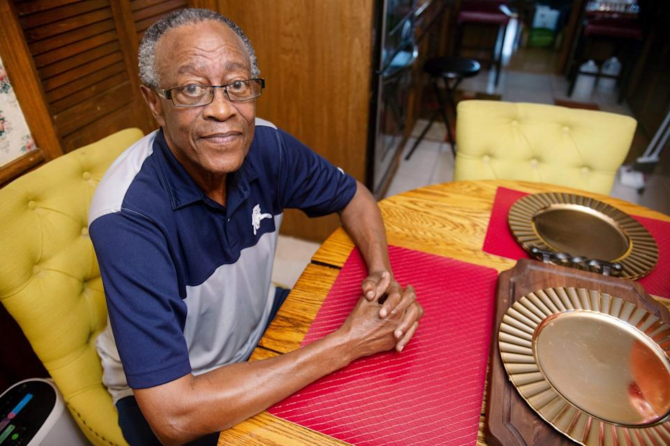 Fred Douglas Moore Clark, a former Freedom Rider, poses for a portrait inside of his home in Jackson, Miss., on July 9, 2021.