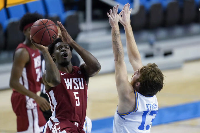 Washington State guard T.J. Bamba (5) shoots against UCLA guard Jake Kyman (13) during the first half of an NCAA college basketball game Thursday, Jan. 14, 2021, in Los Angeles. (AP Photo/Ashley Landis)