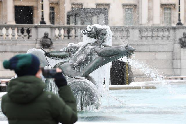 An ice-covered mermaid statue