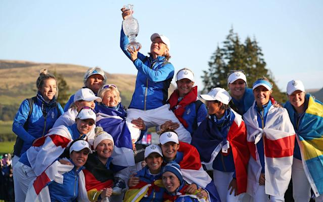 Team Europe captain Catriona Matthew (top) celebrates with her team - PA