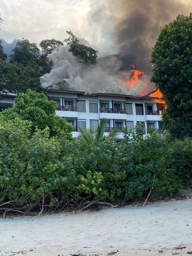 Fire razing the Andaman Resort building. Photo: Megtgmez/Twitter
