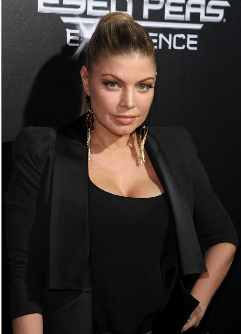 FILE - In this Nov. 21, 2011 file photo originally released by Ubisoft, singer Fergie, of the Black Eyed Peas, arrives at Ubisoft's The Black Eyed Peas Experience Launch Party in Los Angeles. Fergie has officially changed her name: The singer born Stacy Ann Ferguson is now Fergie Duhamel. The Grammy winner's representative confirmed the name change Friday, Aug. 16, 2013. (AP Photo/Ubisoft, Casey Rodgers, File)