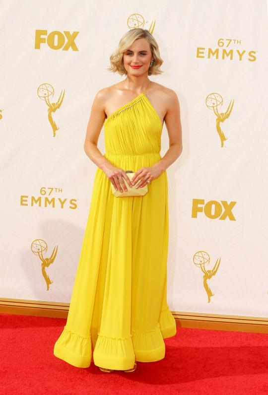 <p>Taylor Schilling shined as bright as the sun — literally, I'm blind — in a Stella McCartney dress. The peplum hemline hit just at the ankle and the one shoulder ruched fabric. That many techniques in one piece would usually be a recipe for disaster but instead it came together wonderfully. </p>