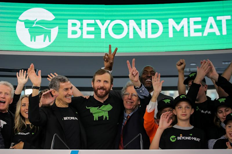 Ethan Brown, founder and CEO of Beyond Meat, and guests ring the opening bell to celebrate his company's IPO at the Nasdaq Market site in New York, U.S., May 2, 2019. REUTERS/Brendan McDermid