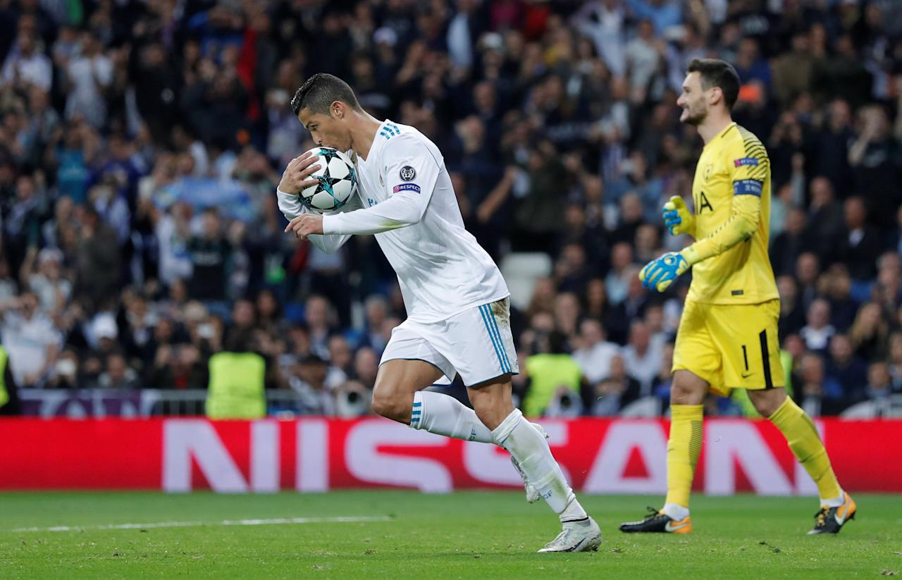 Soccer Football - Champions League - Real Madrid vs Tottenham Hotspur - Santiago Bernabeu Stadium, Madrid, Spain - October 17, 2017   Real Madrid's Cristiano Ronaldo celebrates scoring their first goal from the penalty spot as Tottenham's Hugo Lloris looks dejected   Action Images via Reuters/Andrew Couldridge