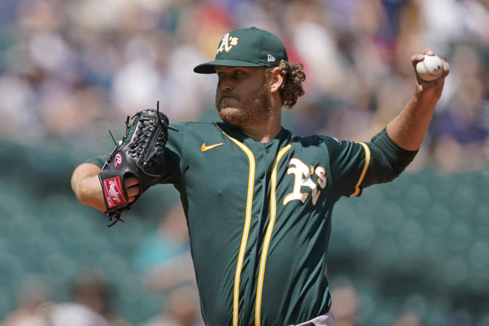 Oakland Athletics starting pitcher Cole Irvin throws against the Seattle Mariners during the first inning of a baseball game, Sunday, July 25, 2021, in Seattle. (AP Photo/Ted S. Warren)