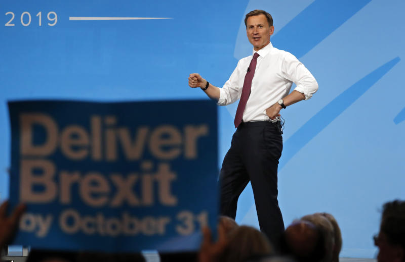 Conservative party leadership candidate Jeremy Hunt takes questions during a Conservative leadership hustings at ExCel Centre in London, Wednesday, July 17, 2019. The two contenders, Jeremy Hunt and Boris Johnson are competing for votes from party members, with the winner replacing Prime Minister Theresa May as party leader and Prime Minister of Britain's ruling Conservative Party. (AP Photo/Frank Augstein)