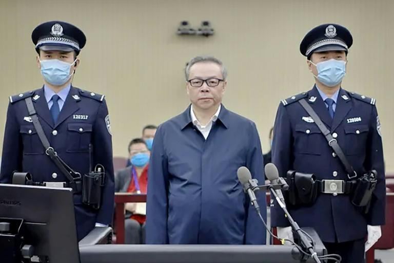 Lai Xiaomin (C) gave a detailed confession on state television last year, which showed footage of safes and cabinets stuffed with cash in an apartment allegedly belonging to him