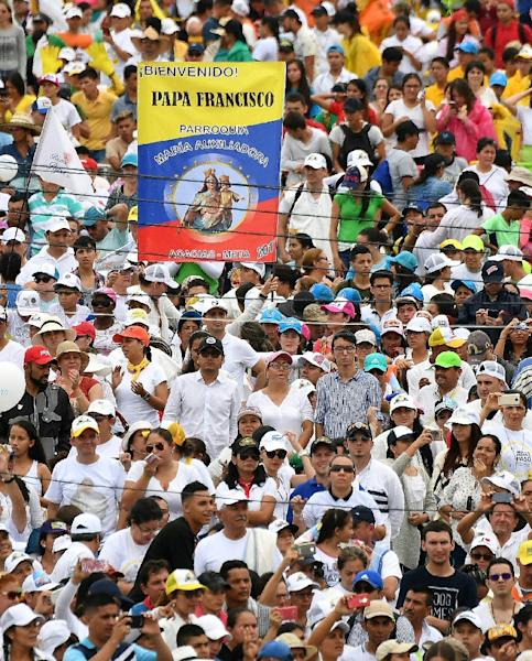People listen as Pope Francis gives an open air mass in Villavicencio, Colombia (AFP Photo/Alberto PIZZOLI)