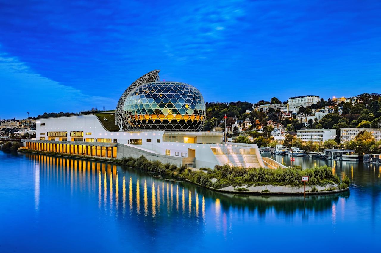 Located on Île Seguin, an island on the Seine River in the western suburbs of Paris, France, La Seine Musicale is a striking music and performing arts center. Designed by Shigeru Ban and Jean de Gastines, the structure was completed in spring 2017. Much of the energy that runs the building comes from a curved solar panel that covers an auditorium.