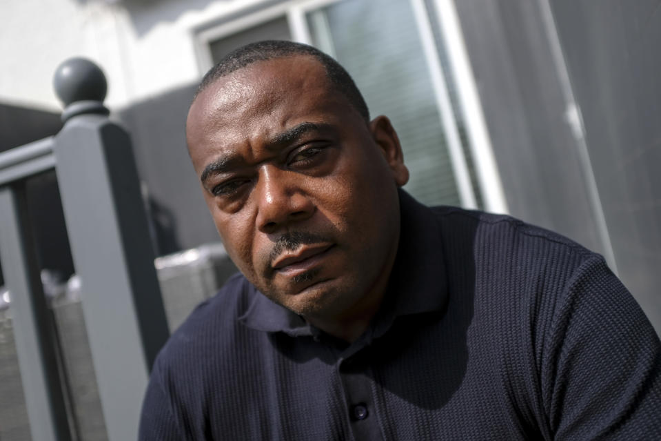 Lee Lawrence poses for a portrait at his house, in London, Wednesday, April 21, 2021. Lawrence's mother, Cherry Groce, was shot by police during a raid on her London home in 1985. She was left paralyzed from the waist down and died in 2011 after spending 26 years in a wheelchair. Her shooting triggered the 1985 Brixton riots, and her family have been fighting for justice ever since. (AP Photo/Alberto Pezzali)