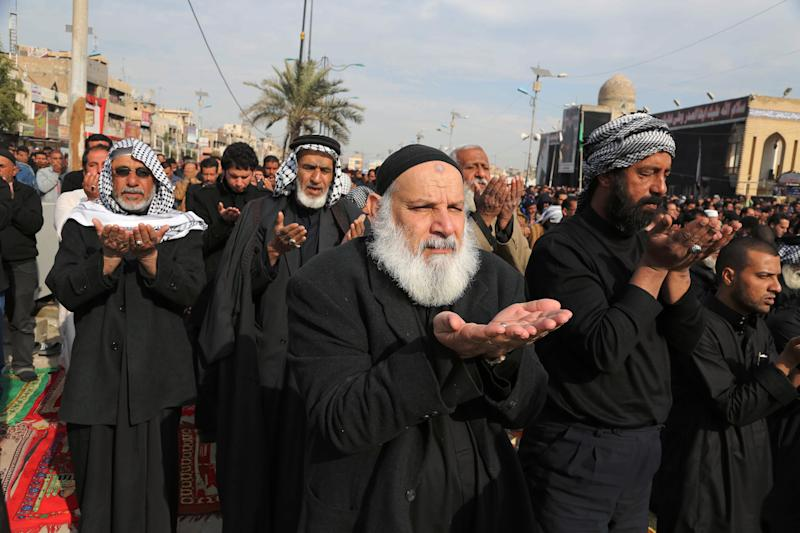 Followers of Shiite cleric Muqtada al-Sadr crowd a street as they attend open air Friday prayers in the Shiite stronghold of Sadr City in Baghdad, Iraq, Friday, Dec. 27, 2013. (AP Photo/Karim Kadim)