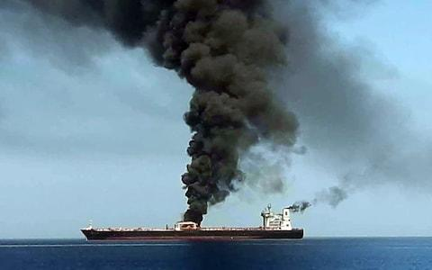 This picture, obtained by AFP from Iranian State TV IRIB, reportedly shows smoke billowing from a tanker  - Credit: IRIB/AFP