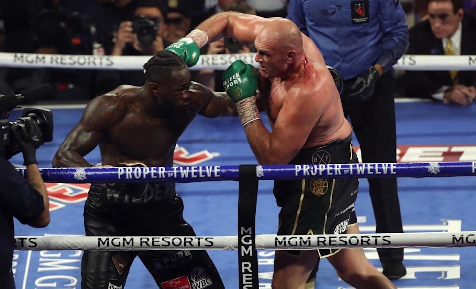 Tyson Fury (right) and Deontay Wilder during the World Boxing Council World Heavy Title bout at the MGM Grand, Las Vegas. (Photo by Bradley Collyer/PA Images via Getty Images)