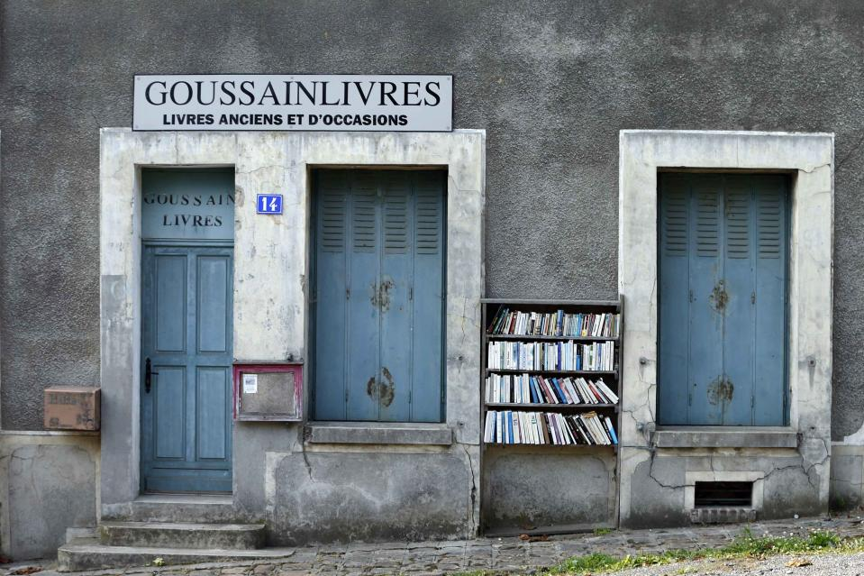 Free books are displayed outside a book shop. The houses are boarded up, the church bells no longer ring out and the town squares are now deserted. (Reuters)