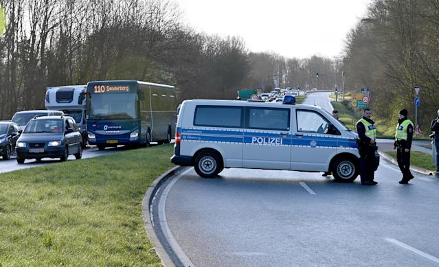 Federal police officers set up a checkpoint at the German-Danish border for drivers coming from Denmark. (Photo by Carsten Rehder/picture alliance via Getty Images)