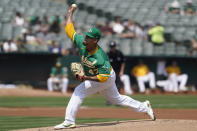 Oakland Athletics' Frankie Montas pitches against the New York Yankees during the first inning of a baseball game in Oakland, Calif., Saturday, Aug. 28, 2021. (AP Photo/Jeff Chiu)
