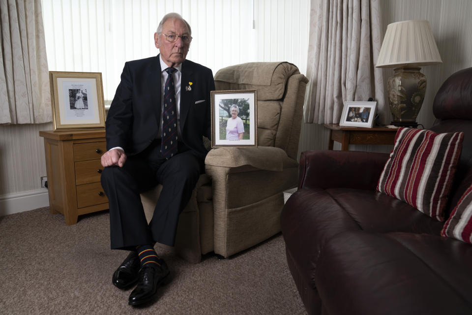 "Retired Major Gordon Bonner holds a photograph of his wife Muriel who, in April 2020 died of COVID-19, at his home in Leeds, England, Saturday Jan. 23, 2021. For nine months, Bonner has been in the ""hinterlands of despair and desolation"" after losing Muriel, his wife of 63 years, to the coronavirus pandemic that has now taken the lives of more than 100,000 people in the United Kingdom.( AP Photo/Jon Super)"