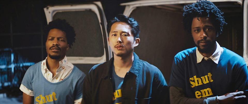"""<p>In 2018, Yeun appeared in Boots Riley's wildly original, dark sci-fi comedy <em>Sorry to Bother You</em>, as union organizer Squeeze. The film follows Cassius """"Cash"""" Green (LaKeith Stanfield) as he uses his """"white voice"""" to become more successful at his telemarketing job and decide if he wants to continue to get rich or fight the powers that be with his union-forming colleagues. </p>"""