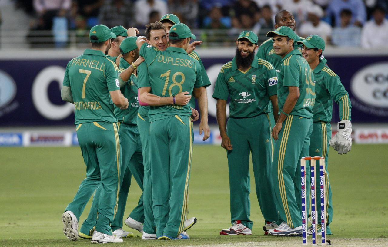 South Africa's Dale Steyn (C) celebrates with his team mates the wicket of Pakistan's Sohaib Maqsood during their first Twenty20 international cricket match in Dubai November 13, 2013. REUTERS/Nikhil Monteiro(UNITED ARAB EMIRATES - Tags: SPORT CRICKET)