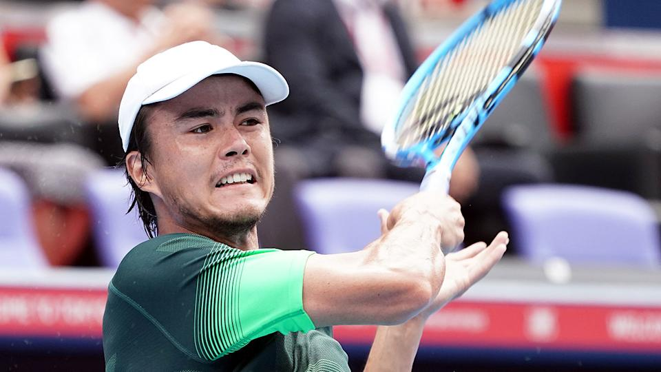 Japan's Taro Daniel is pictured here returning a shot in a tennis match.