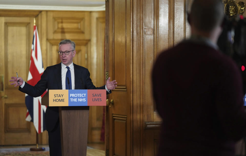 In this image made available by British government because no media allowed into 10 Downing Street because of the coronavirus pandemic, showing British lawmaker Michael Gove holding a Digital Press Conference on COVID-19, in 10 Downing Street, London, Friday March 27, 2020. Prime Minister Boris Johnson tested positive for the COVID-19 coronavirus Friday along with other members of the government, and has self isolated. (Pippa Fowles / No 10 Downing Street via AP)