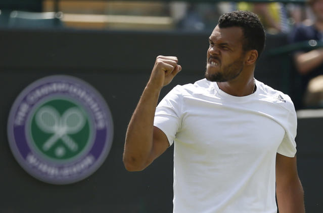 Jo-Wilfried Tsonga of France celebrates winning against Juergen Melzer of Austria during their first round match at the All England Lawn Tennis Championships in Wimbledon, London, Tuesday, June 24, 2014. (AP Photo/Pavel Golovkin)