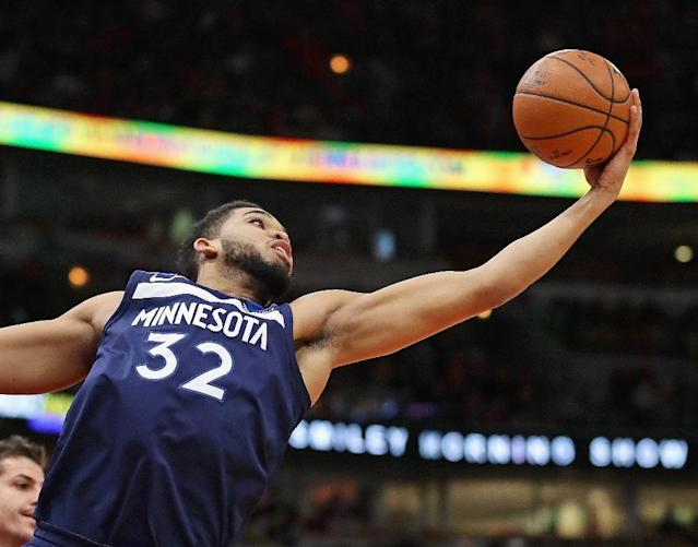 Karl-Anthony Towns of the Minnesota Timberwolves dominated inside, finishing with 31 points and 16 rebounds, against the Golden State Warriors (AFP Photo/JONATHAN DANIEL)