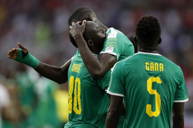 Senegal players celebrate after winning the group H match between Poland and Senegal at the 2018 soccer World Cup in the Spartak Stadium in Moscow, Russia, Tuesday, June 19, 2018. Senegal won Poland 2-1. (AP Photo/Eduardo Verdugo)