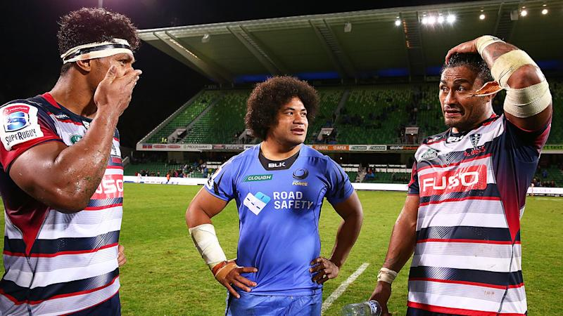 Pictured here, Lopeti Timani and Amanaki Mafi chat after a Super Rugby match for the Rebels.