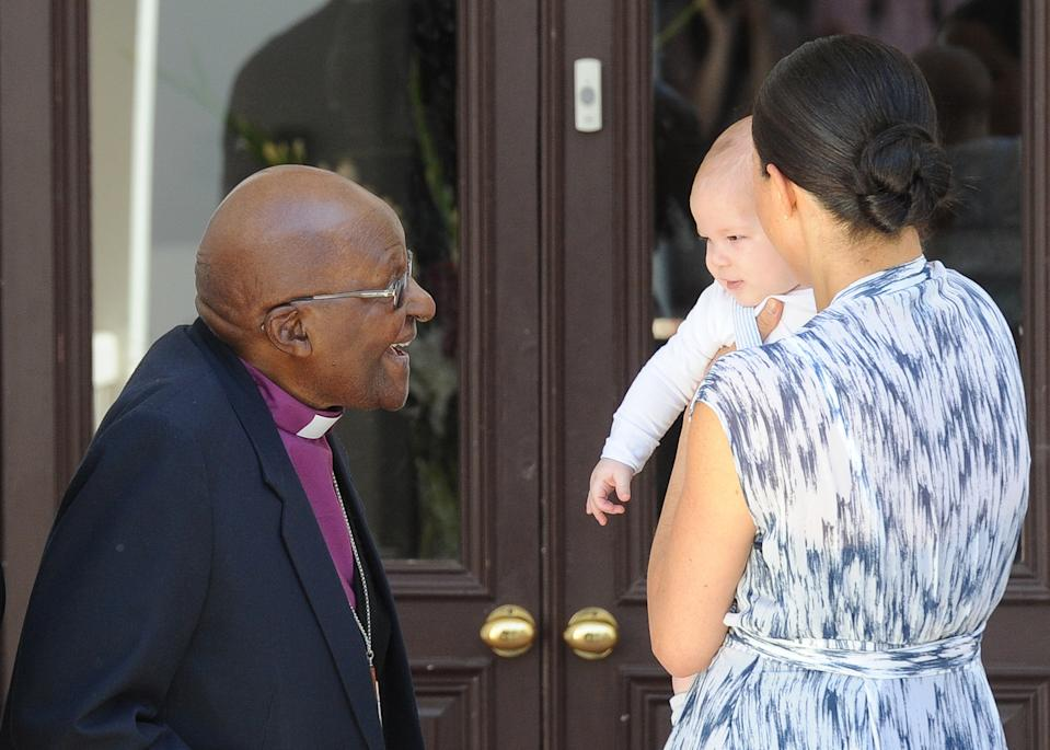 Britain's Duchess of Sussex Meghan, hold herbaby son Archie as they meet with Archbishop Desmond Tutu at the Tutu Legacy Foundation  in Cape Town on September 25, 2019. (Photo by HENK KRUGER / POOL / AFP)        (Photo credit should read HENK KRUGER/AFP via Getty Images)