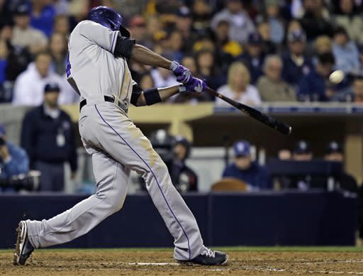Colorado Rockies' Dexter Fowler connects for a solo homer against the San Diego Padres in the ninth inning of a baseball game Friday April 12, 2013 in San Diego.The homer broke a tie score. (AP photo/Lenny Ignelzi)