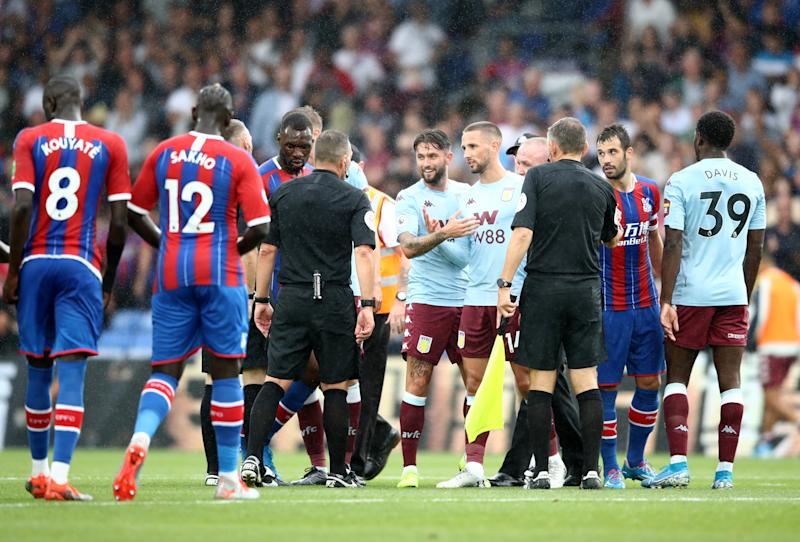 LONDON, ENGLAND - AUGUST 31: Conor Hourihane and Henri Lansbury of Aston Villa speaks to match referee Kevin Friend following the Premier League match between Crystal Palace and Aston Villa at Selhurst Park on August 31, 2019 in London, United Kingdom. (Photo by Bryn Lennon/Getty Images)