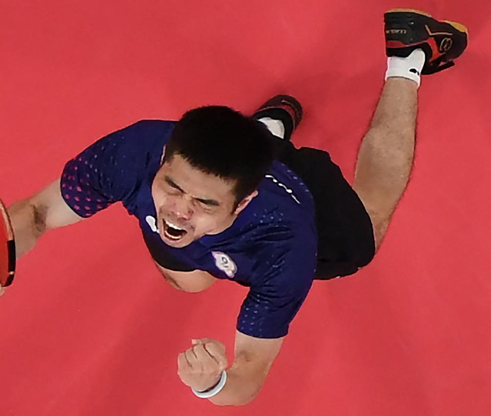 An overview image shows Taiwan's Chuang Chih-yuan celebrating his victory over Hong Kong's Wong Chun-ting in his men's singles round 3 table tennis match at the Tokyo Metropolitan Gymnasium during the Tokyo 2020 Olympic Games in Tokyo on July 26, 2021. (Photo by Jung Yeon-je / POOL / AFP) (Photo by JUNG YEON-JE/POOL/AFP via Getty Images)