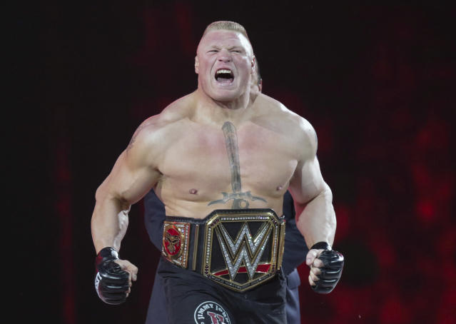 FILE - In this March 29, 2015, file photo, Brock Lesnar makes his entrance at Wrestlemania XXXI in Santa Clara, Calif. While real sports have shut down in the wake of the coronavirus pandemic, WWE has pressed on and is set to run this weekend its first WrestleMania in an empty arena. WWE stood firm that the show must go on and largely moved a card highlighted by stars Brock Lesnar and John Cena to its performance center in Orlando, Florida. (AP Photo/Don Feria, File)