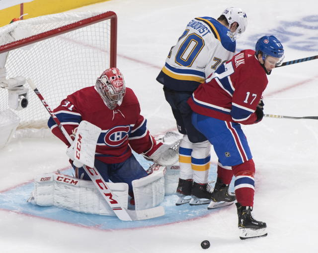 St. Louis Blues' Oskar Sundqvist (70) moves in on Montreal Canadiens goaltender Carey Price as Canadiens' Brett Kulak defends during second period NHL hockey action in Montreal, Saturday, Oct. 12, 2019. (Graham Hughes/The Canadian Press via AP)