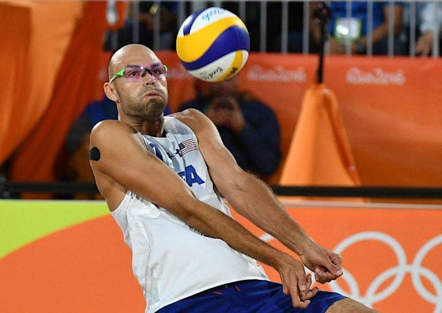 """USA's <a class=""""link rapid-noclick-resp"""" href=""""/olympics/rio-2016/a/1105749/"""" data-ylk=""""slk:Phil Dalhausser"""">Phil Dalhausser</a> (LEON NEAL/AFP/Getty Images)"""