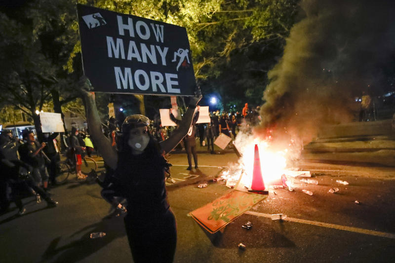 Demonstrators gather to protest the death of George Floyd, Sunday, May 31, 2020, near the White House in Washington. Floyd died after being restrained by Minneapolis police officers (Alex Brandon/AP)