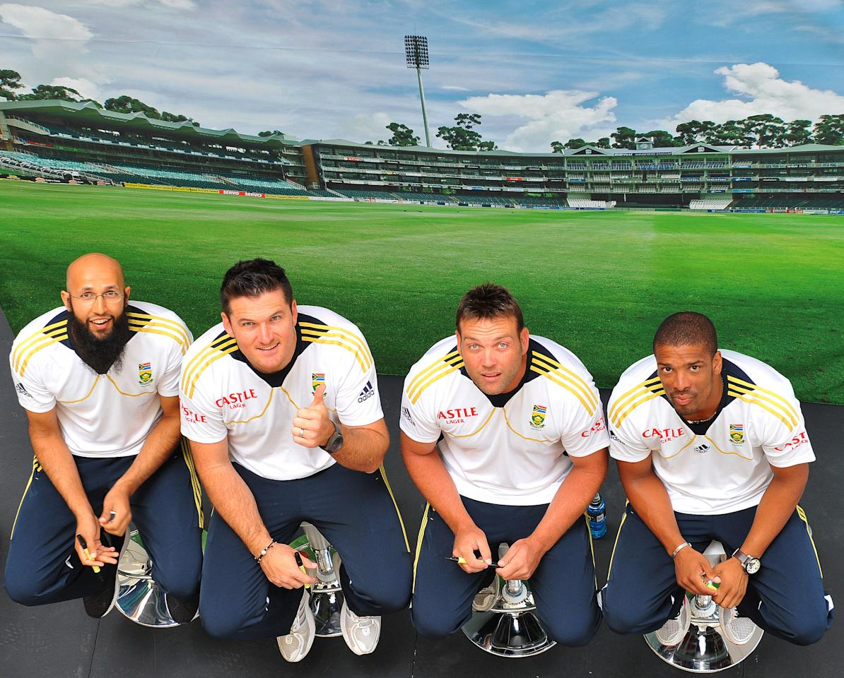 JOHANNESBURG, SOUTH AFRICA - JANUARY 29:  (L-R) Hashim Amla, Graeme Smith, Jacques Kallis and Vernon Philander during a South Africa National cricket team signing session ahead of Graeme Smith's 100th Test as captain at Sandton City on January 29, 2013 in Johannesburg, South Africa.  (Photo by Duif du Toit/Gallo Images/Getty Images)