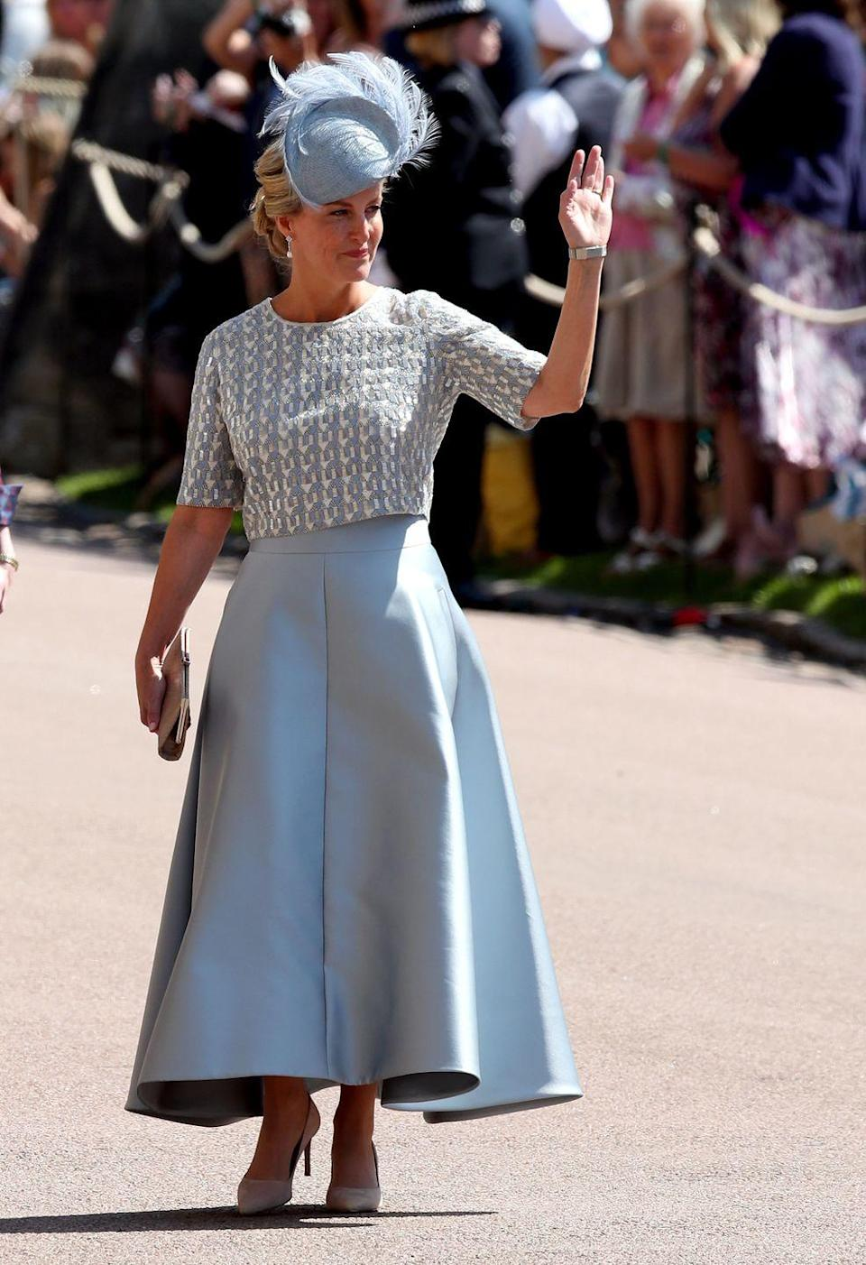 """<p>Sophie, the Countess of Wessex, in a soft blue ensemble designed by Suzannah at <a href=""""https://www.townandcountrymag.com/the-scene/weddings/a9936314/prince-harry-meghan-markle-wedding/"""" rel=""""nofollow noopener"""" target=""""_blank"""" data-ylk=""""slk:her nephew Prince Harry's wedding to Meghan Markle."""" class=""""link rapid-noclick-resp"""">her nephew Prince Harry's wedding to Meghan Markle.</a> She is also wore a hat by Jane Taylor.</p>"""