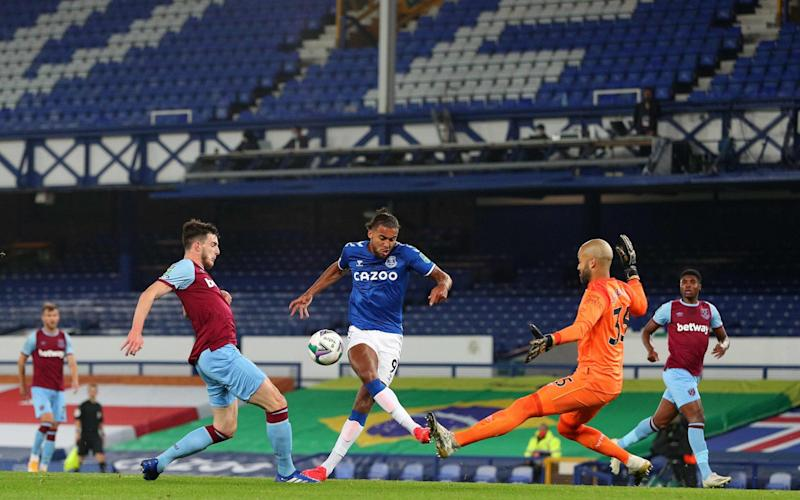 Everton's English striker Dominic Calvert-Lewin (C) shoots past West Ham United's Irish goalkeeper Darren Randolph (R) to score the opening goal  - PETER BYRNE/POOL/AFP via Getty Images
