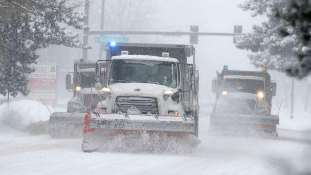 PHOTO: City of Denver snowplows clear the eastbound lanes of Speer Blvd. as a storm packing snow and high winds sweeps in over the region, Nov. 26, 2019, in Denver. (David Zalubowski/AP)